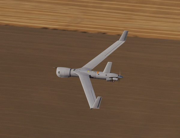 ScanEagle flying over field